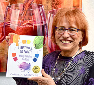 "Carol McIntyre with her award winning book, ""I Just Want to Paint!"""